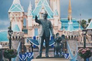 House Sparrow on Head of Walt Disney and Mickey Mouse
