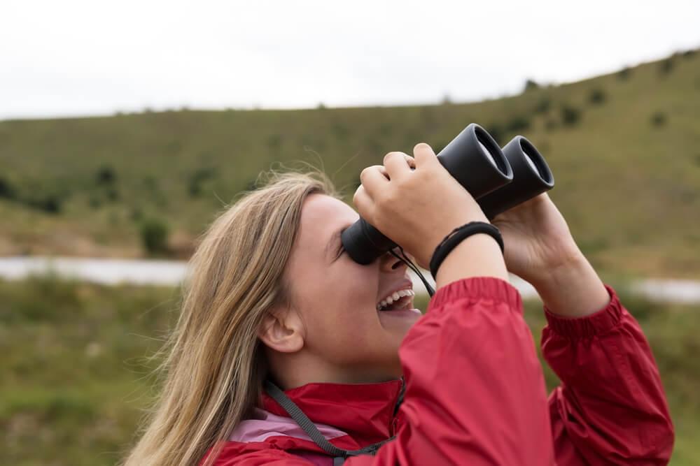 girl testing out new binoculars